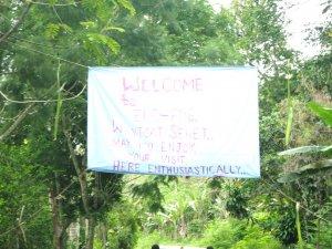 Gruß mit der Aufschrift: Willkommen bei der ev.- luth. Kirche in PNG, im Dekanat Wantoat - mögt ihr euern Aufenthalt hier begeistert genießen